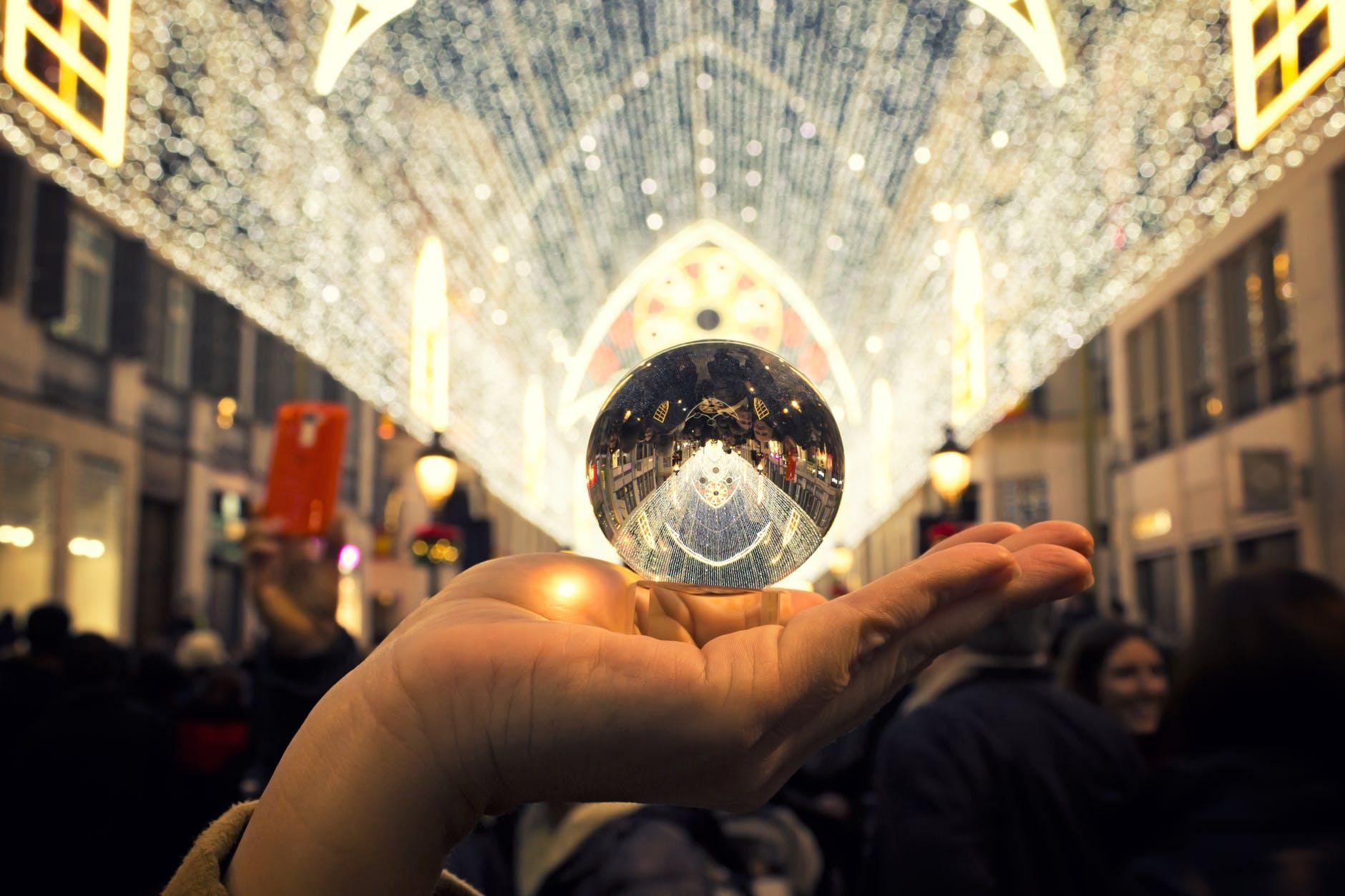person holding round silver colored accessory