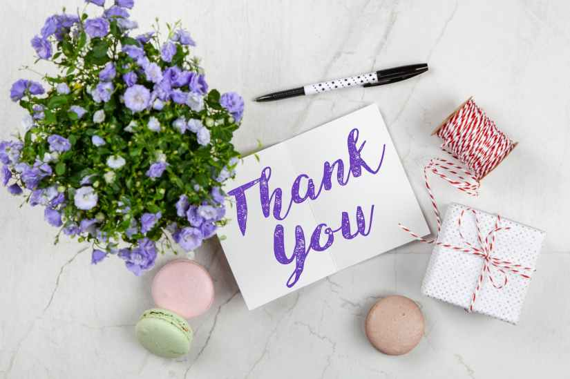 purple petaled flower and thank you card